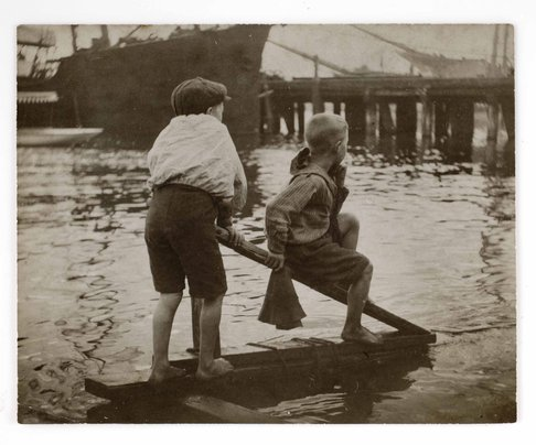Sydney Harbour scenes: two boys on a raft